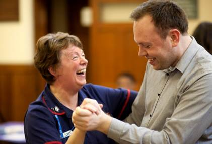 Nurse and patient dancing at tea dance South West Yorkshire Partnership NHS Foundation Trust