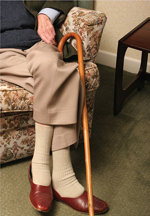 elderly man sat down with walking stick South West Yorkshire Partnership NHS Foundation Trust