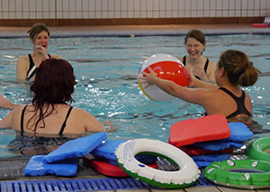 group of women throwing a ball in the pool South West Yorkshire Partnership NHS Foundation Trust