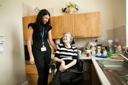 staff caring for woman in kitchen South West Yorkshire Partnership NHS Foundation Trust