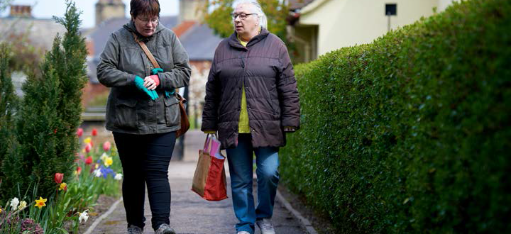 two women walking down a path South West Yorkshire Partnership NHS Foundation Trust