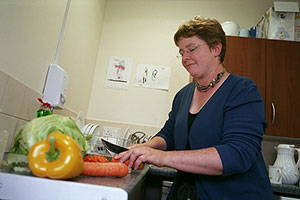 woman cutting vegetables South West Yorkshire Partnership NHS Foundation Trust