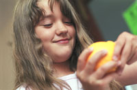 girl peeling orange South West Yorkshire Partnership NHS Foundation Trust