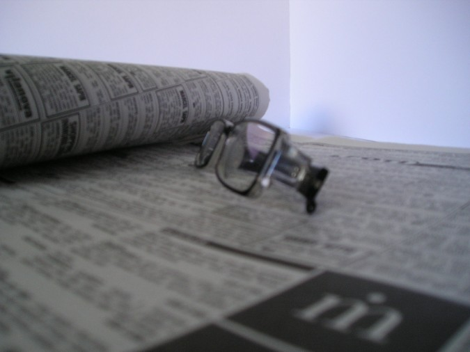 glasses and newspaper South West Yorkshire Partnership NHS Foundation Trust