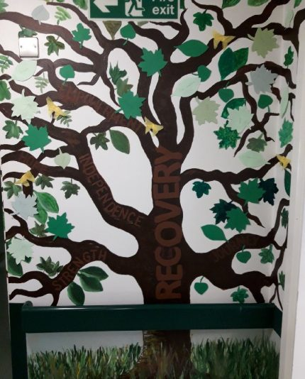 A recovery tree painted on the walls of Willow Ward.