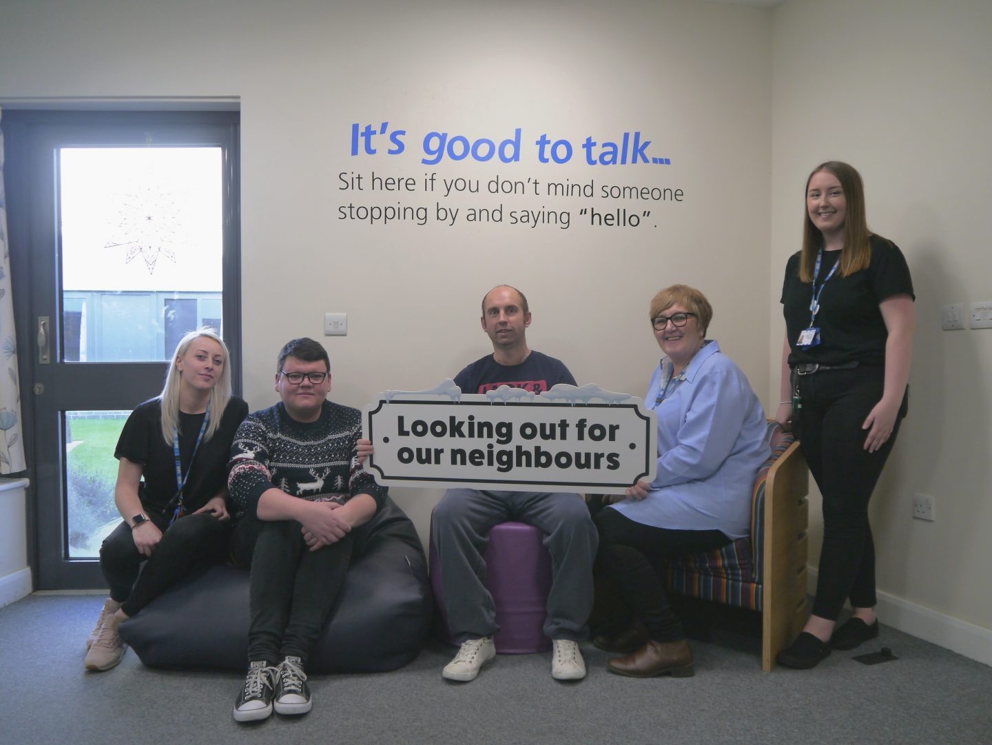 Staff and patients on Stanley Ward supporting the Looking out for our neighbours campaign